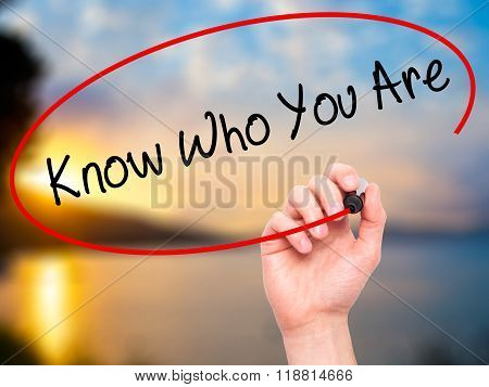 Man Hand Writing Know Who You Are With Black Marker On Visual Screen