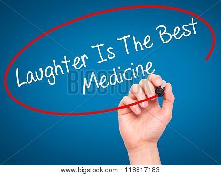 Man Hand Writing Laughter Is The Best Medicine  With Black Marker On Visual Screen