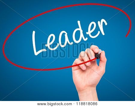 Man Hand Writing Leader With Black Marker On Visual Screen