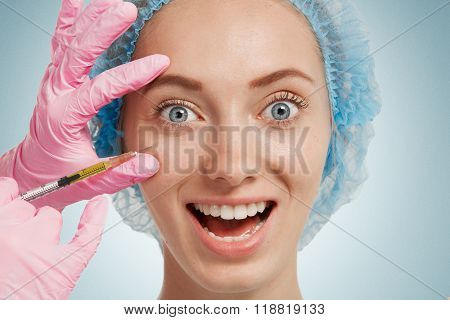 Reduction Of Wrinkles, Injection, Nasal Labial Folds. Portrait Of A White Woman During Surgery Filli