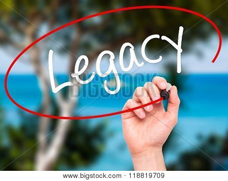 Man Hand Writing Legacy With Black Marker On Visual Screen
