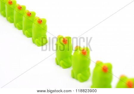 Platoon green toy frogs.