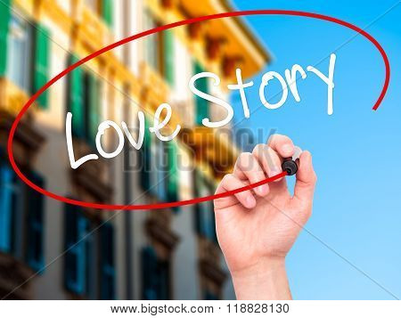 Man Hand Writing Love Story With Black Marker On Visual Screen