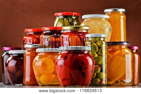 Jars With Fruity Compotes Jams And Pickled Vegetables