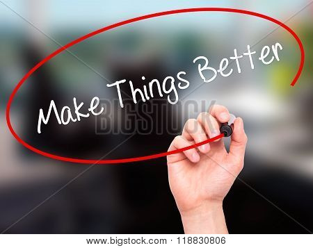 Man Hand Writing   Make Things Better With Black Marker On Visual Screen