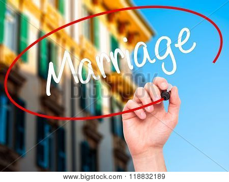 Man Hand Writing Marriage With Black Marker On Visual Screen