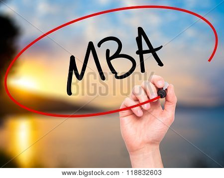 Man Hand Writing Mba With Black Marker On Visual Screen