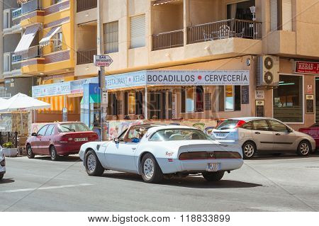 White Modern Sport-car On Sunny Street, Torrevieja, Valencia, Spain