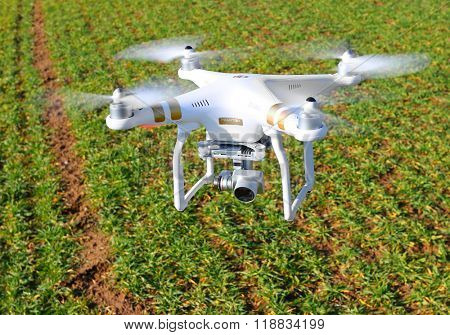 PILSEN CZECH REPUBLIC - FEBRUARY 18, 2016: Drone quadrocopter Dji Phantom 3 Professional with camera. New tool for farmers use drones to inspect of cultivated fields. Modern technology in agriculture.