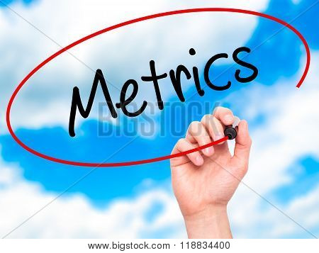 Man Hand Writing  Metrics  With Black Marker On Visual Screen