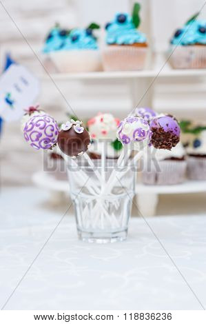 Candy bar with cupcakes Dessert table on wedding dinner