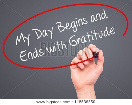 Man Hand Writing My Day Begins And Ends With Gratitude With Black Marker On Visual Screen