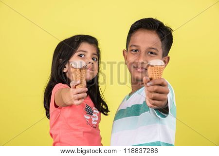 indian girl and boy and ice cream, indian kids eating ice cream, asian kids and ice cream, isolated