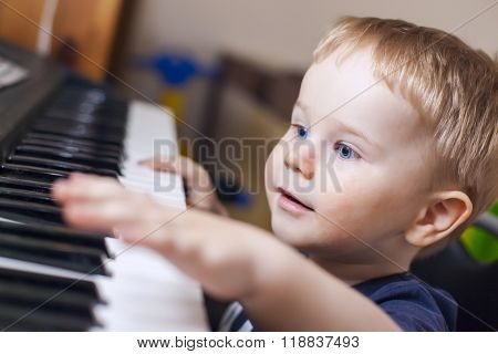 Small Boy Enjoys Playing Electric Piano