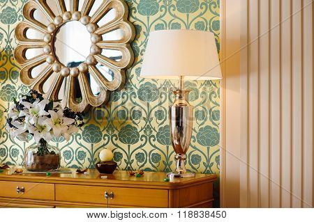 mirror and reading lamps in the bedroom