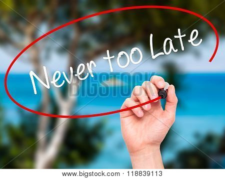 Man Hand Writing Never Too Late With Black Marker On Visual Screen