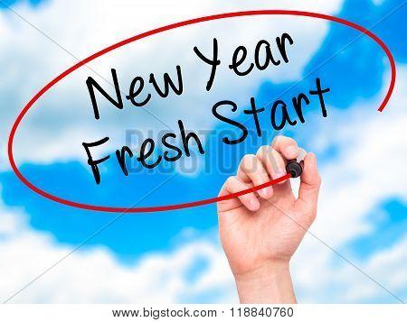 Man Hand Writing New Year Fresh Start With Black Marker On Visual Screen