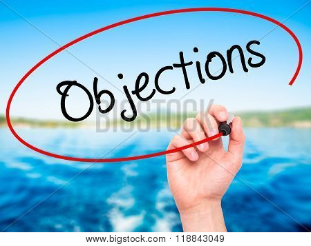 Man Hand Writing Objections  With Black Marker On Visual Screen
