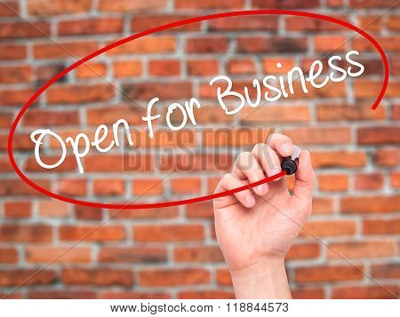Man Hand Writing Open For Business With Black Marker On Visual Screen