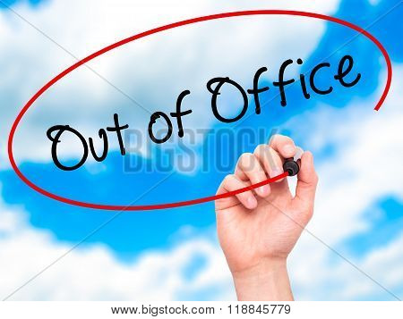 Man Hand Writing Out Of Office With Black Marker On Visual Screen