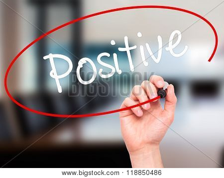Man Hand Writing Positive With Black Marker On Visual Screen