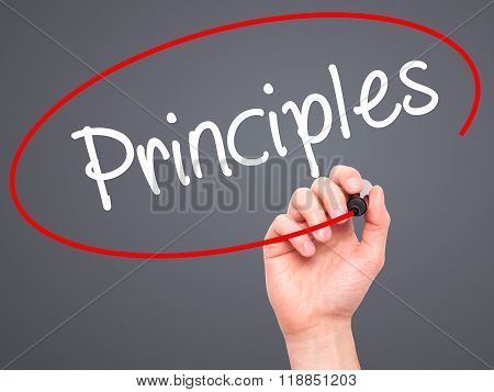 Man Hand Writing Principles With Black Marker On Visual Screen