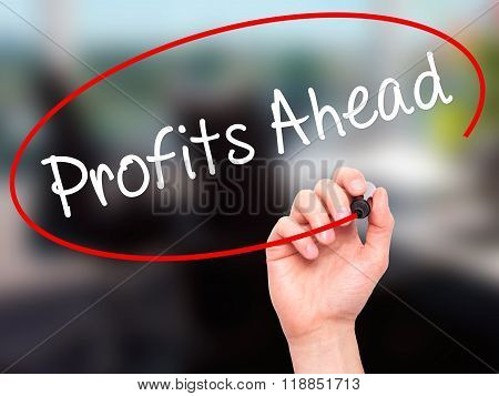 Man Hand Writing Profits Ahead   With Black Marker On Visual Screen