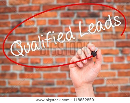 Man Hand Writing Qualified Leads With Black Marker On Visual Screen