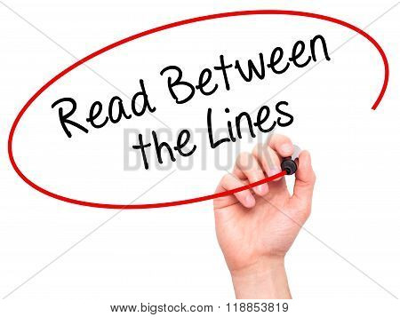 Man Hand Writing Read Between The Lines   With Black Marker On Visual Screen