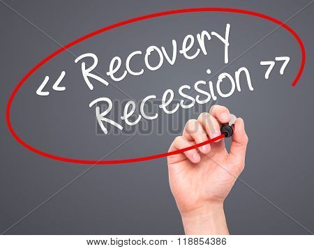 Man Hand Writing  Recovery - Recession With Black Marker On Visual Screen