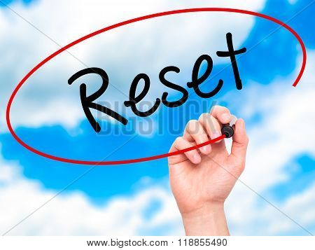 Man Hand Writing Reset With Black Marker On Visual Screen
