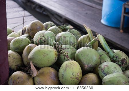 Green Coconuts Being Sold in Market