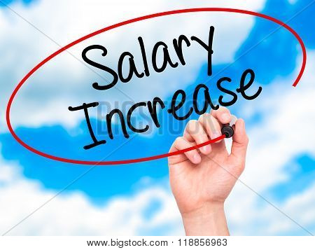 Man Hand Writing Salary Increase With Black Marker On Visual Screen