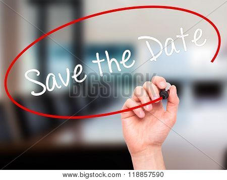 Man Hand Writing Save The Date  With Black Marker On Visual Screen