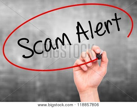 Man Hand Writing Scam Alert  With Black Marker On Visual Screen