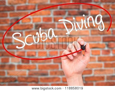 Man Hand Writing Scuba Diving With Black Marker On Visual Screen