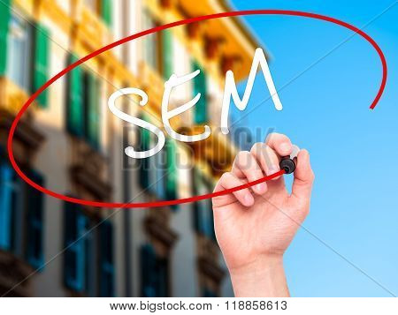 Man Hand Writing  Sem (search Engine Marketing) With Black Marker On Visual Screen