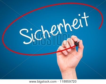 Man Hand Writing Sicherheit (safety In German) With Black Marker On Visual Screen