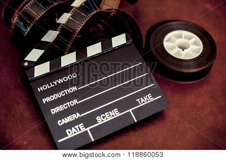 Movie Clapper Board And Filmstrip Selective Focus