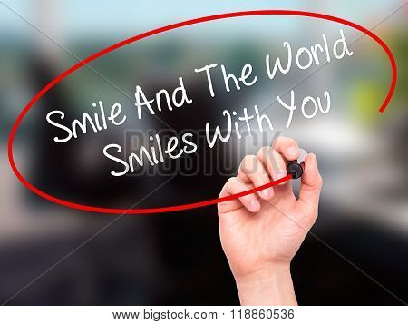 Man Hand Writing Smile And The World Smiles To You With Black Marker On Visual Screen