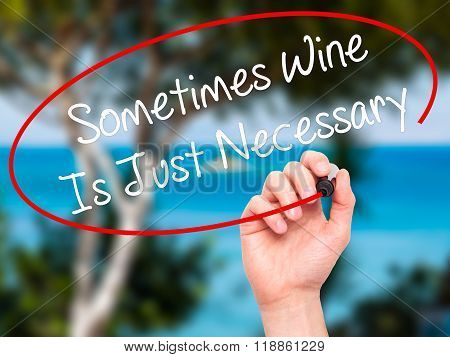 Man Hand Writing Sometimes Wine Is Just Necessary With Black Marker On Visual Screen
