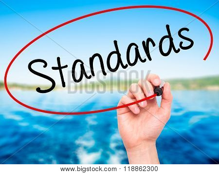 Man Hand Writing Standards With Black Marker On Visual Screen