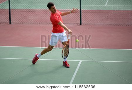 Male Tennis Player Practice In Tennis Court