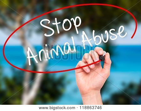 Man Hand Writing Stop Animal Abuse With Black Marker On Visual Screen