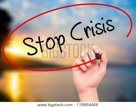 Man Hand Writing Stop Crisis With Black Marker On Visual Screen
