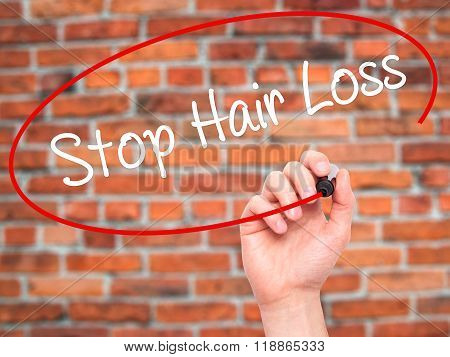 Man Hand Writing Stop Hair Loss  With Black Marker On Visual Screen