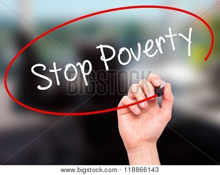 Man Hand Writing Stop Poverty  With Black Marker On Visual Screen