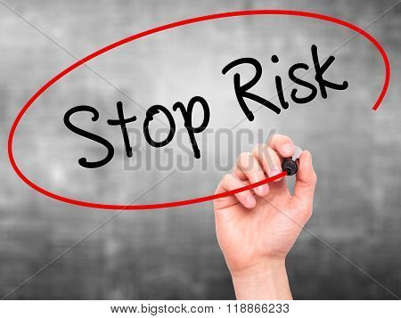 Man Hand Writing Stop Risk With Black Marker On Visual Screen