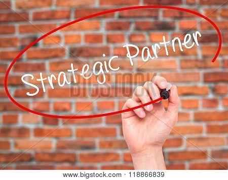 Man Hand Writing Strategic Partner With Black Marker On Visual Screen
