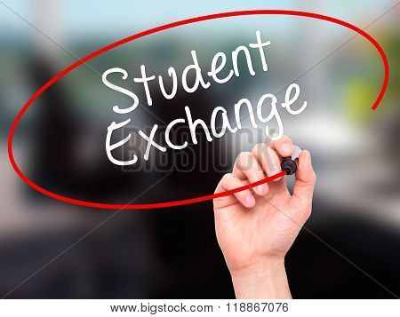Man Hand Writing  Student Exchange With Black Marker On Visual Screen